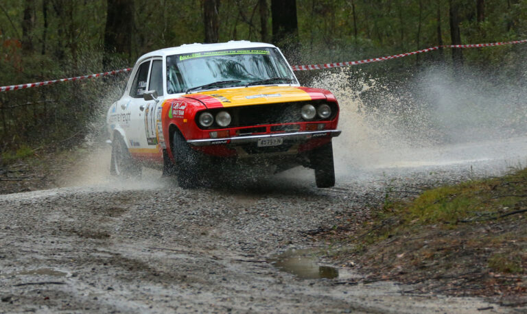Nathan Quinn and Ray Winwood Smith in their Mazda RX2.