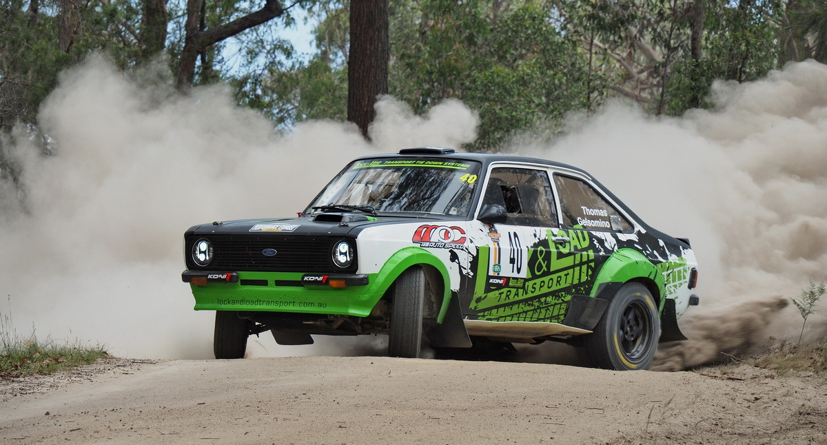 Lock & Load Ford Escort, sideways on a gravel road.